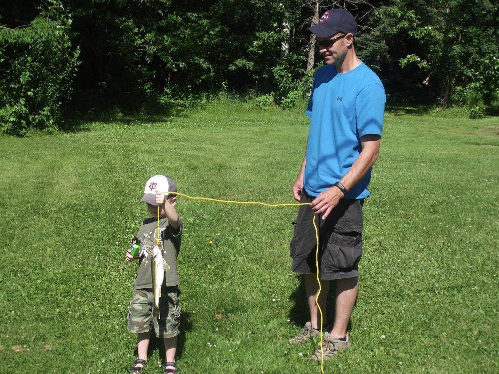 dad and son with walleye on stringer