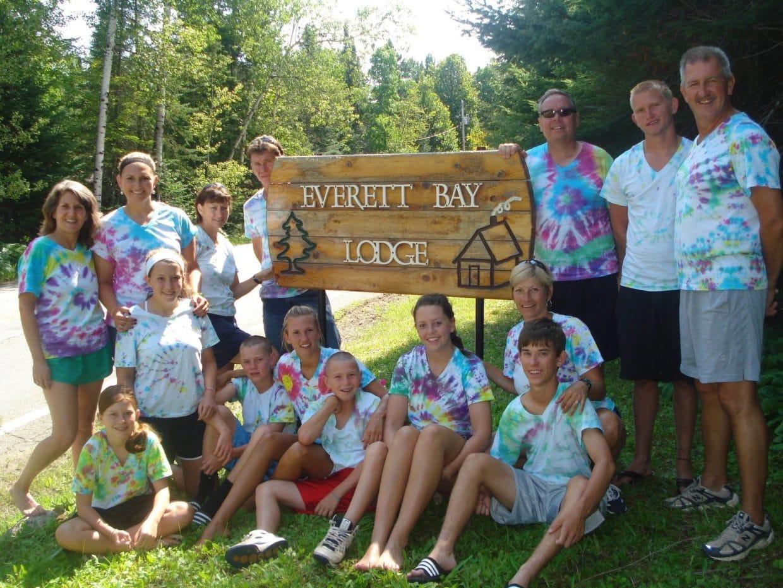 family vacation group at Everett Bay Lodge sign
