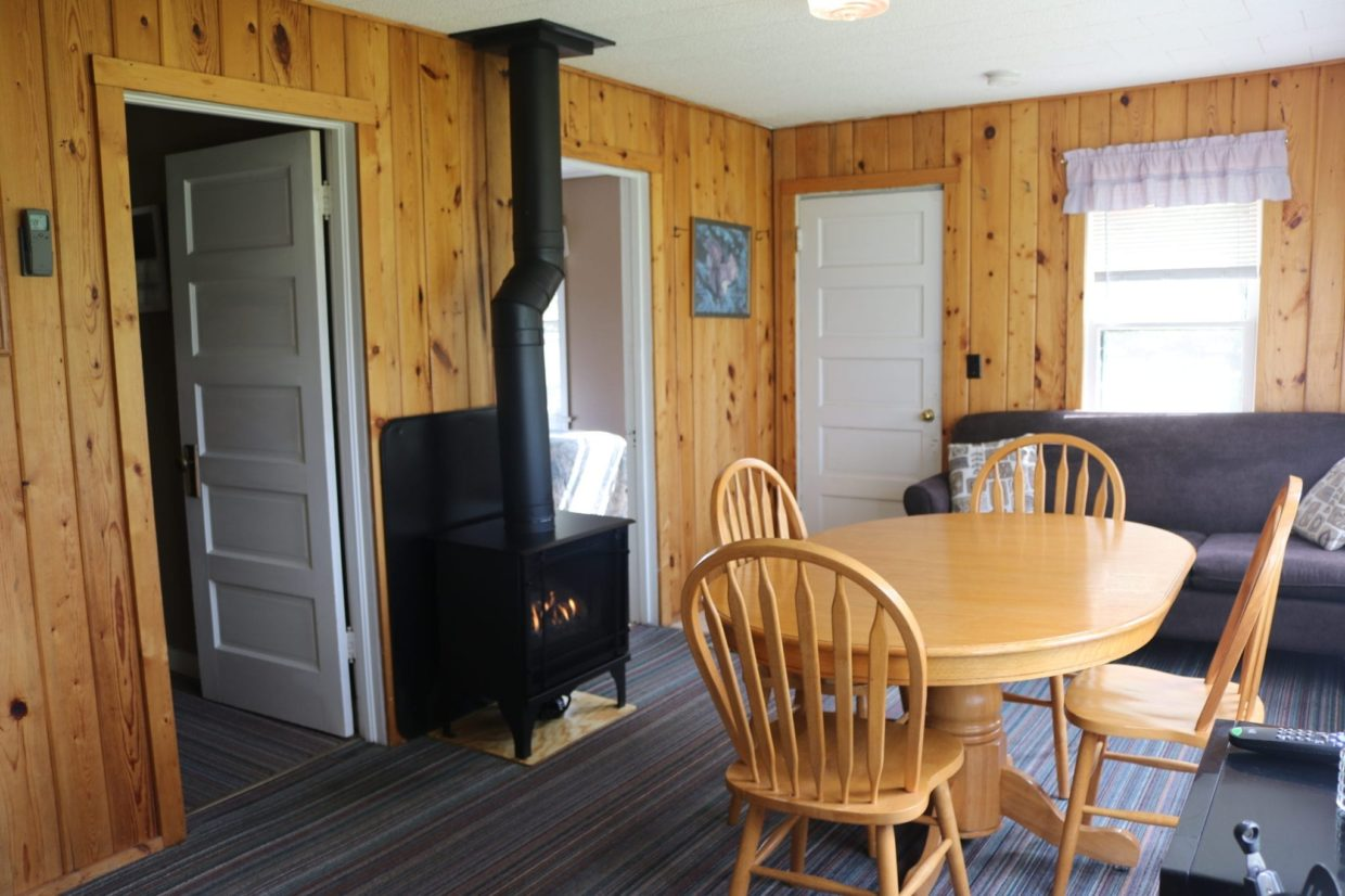 Minnesota resort cabin dining room with fireplace