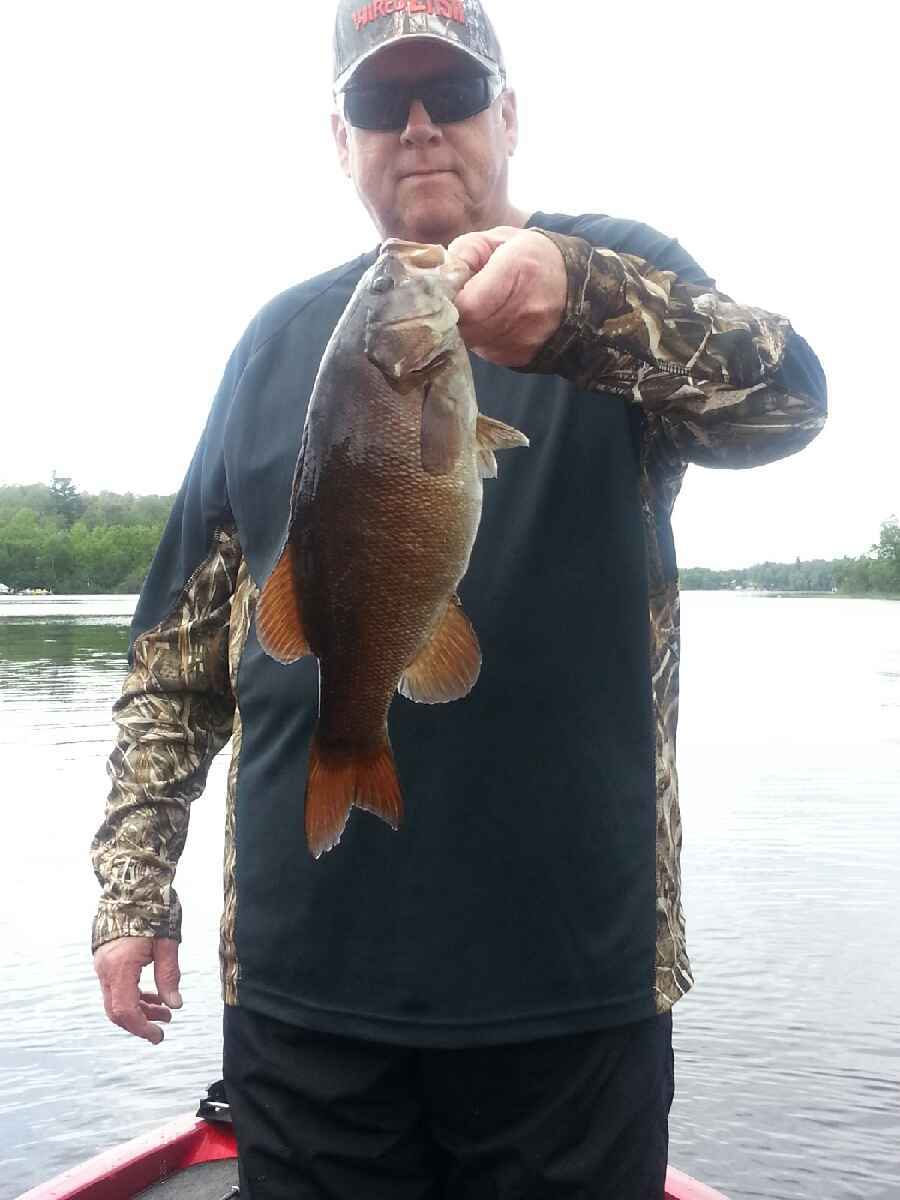 man caught smallmouth bass on Lake Vermilion