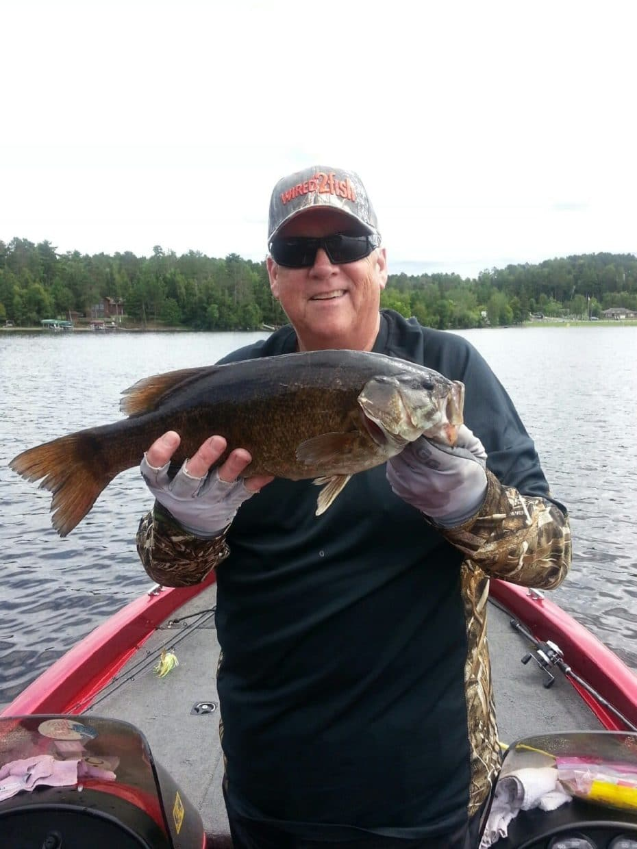 man with smallmouth bass on Lake Vermilion