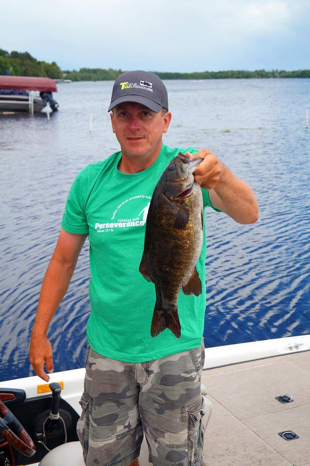 man with Smallie on Lake Vermilion