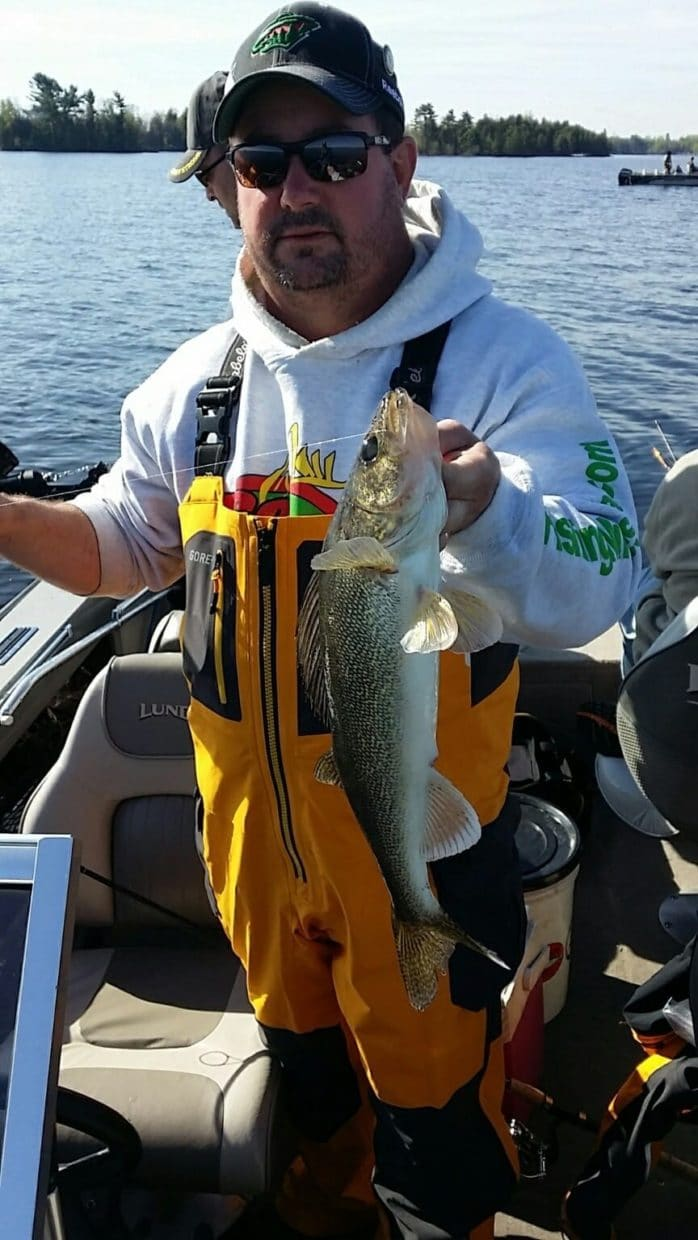 Eric Noyes holding walleye caught on Vermilion