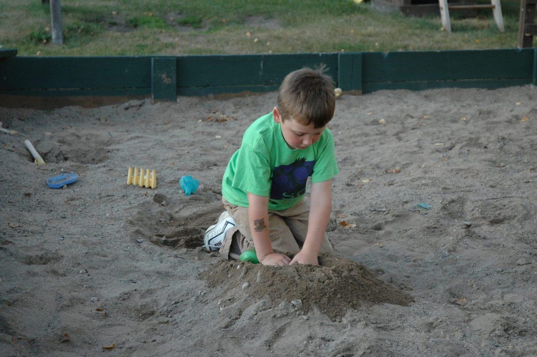 boy in sandbox at Everett Bay Lodge