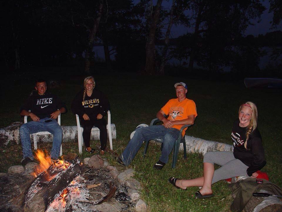 Family vacation campfire at Everett Bay