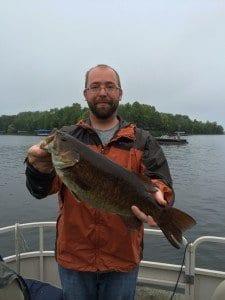man holding smallmouth bass at Lake Vermilion