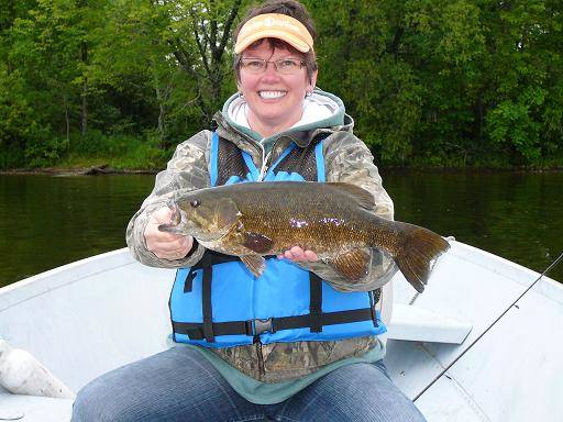 Lisa foster holding bass on Lake Vermilion