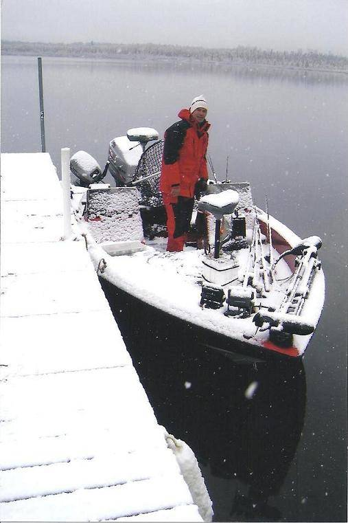 Kretchmer in boat with snow