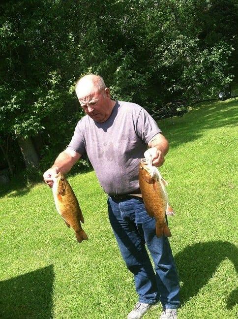 Man with Lake Vermilion smallmouth bass