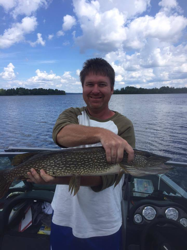 man with minnesota northern pike caught