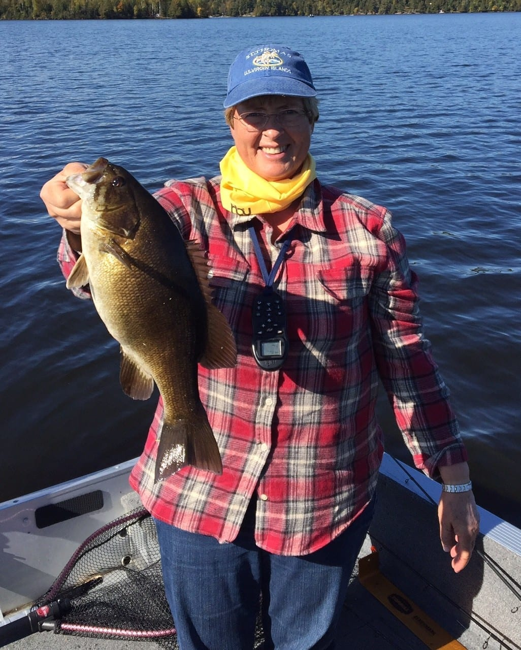 Lady with bass at resort on Lake Vermilion