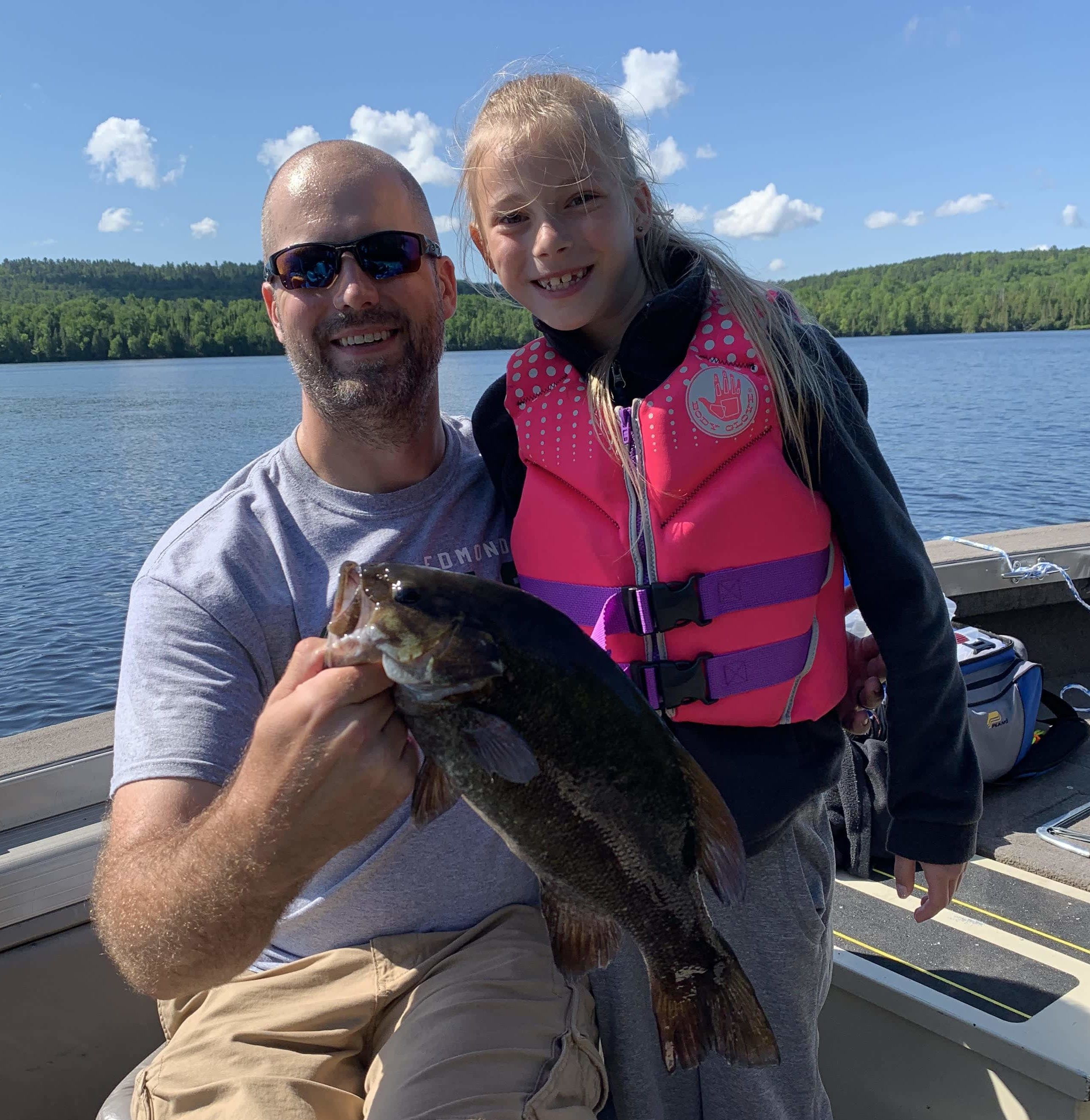 Man and girl with smallmouth bass