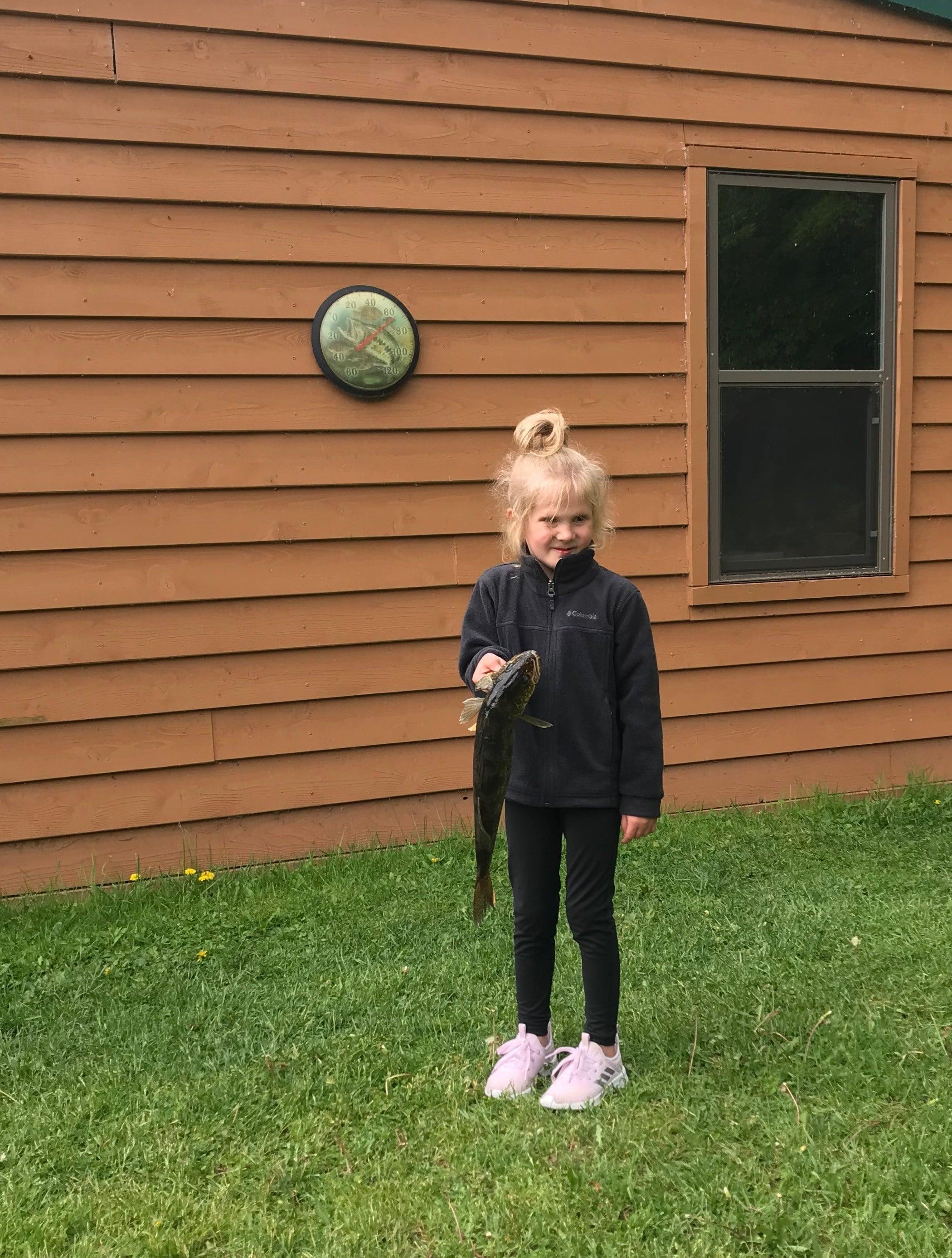 yound girl holding Lake Vermilion walleye