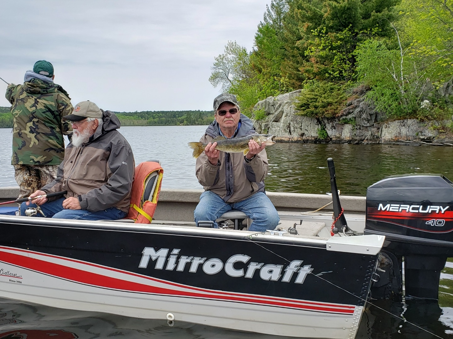 Man in boat with walleye