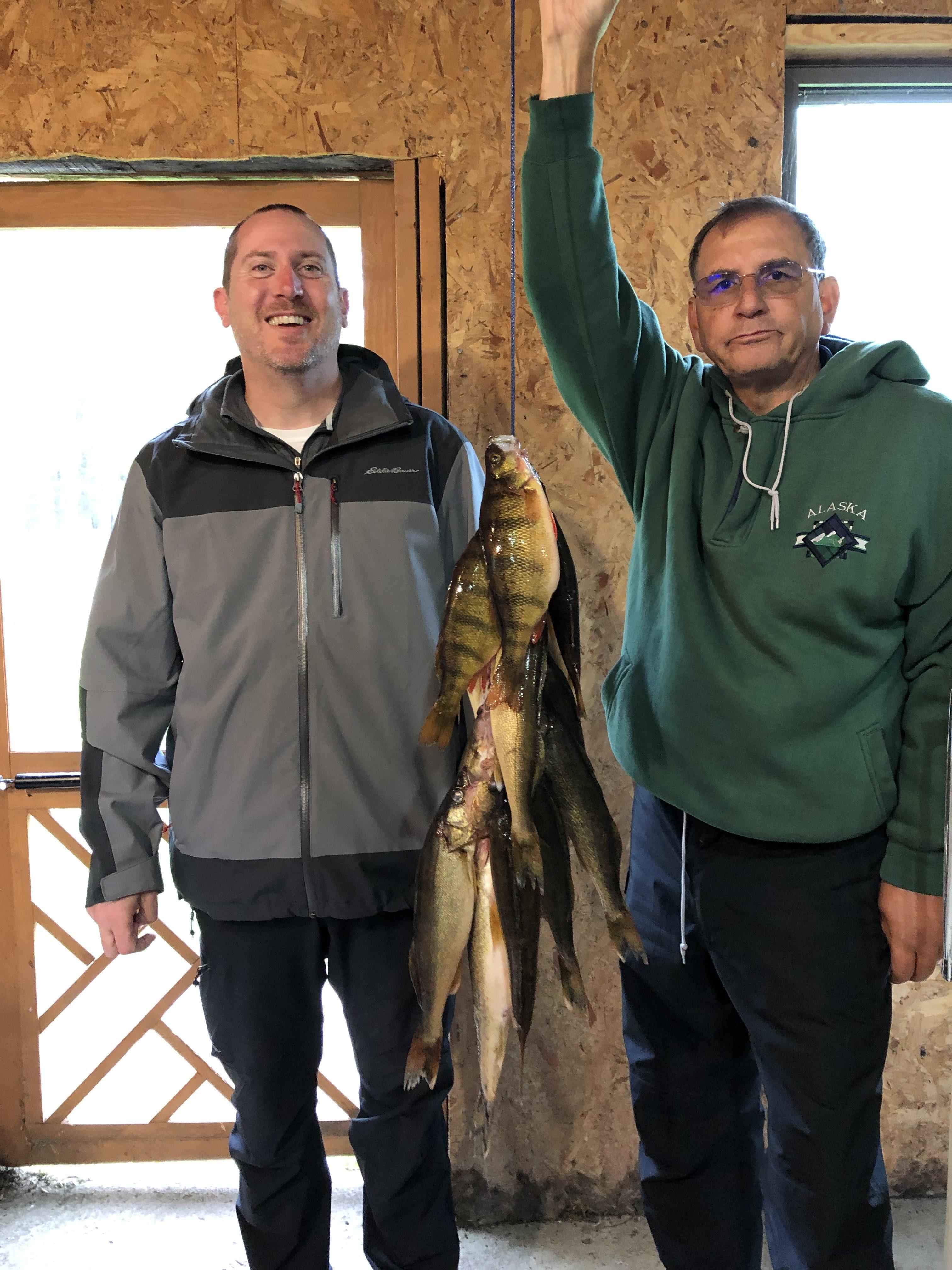2 men with stringer of fish