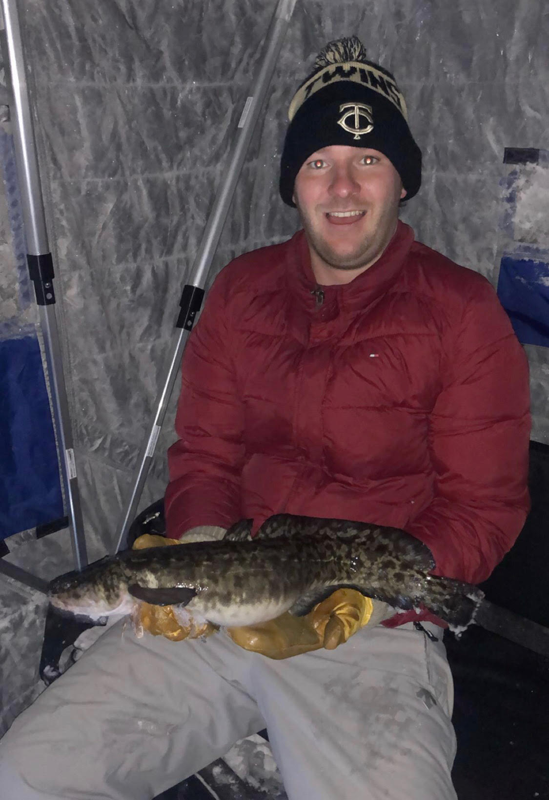man holding eelpout