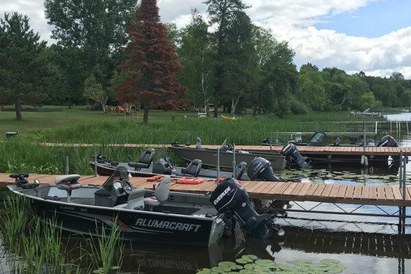 fishing boats with motors alongside docks